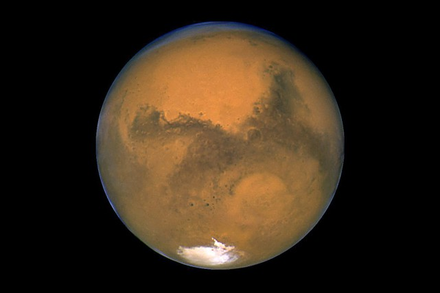 La planète Mars, photographiée en 2003 par le... (PHOTO ARCHIVES NASA VIA AP)