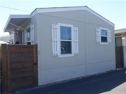 Photo of 7560 Woodman Pl. #54, Van Nuys, CA 91405 (MLS # SR21168362)