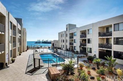 Photo of 1140 E Ocean Boulevard #105, Long Beach, CA 90802 (MLS # OC20129680)