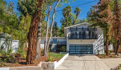 Photo of 21801 San Miguel Street, Woodland Hills, CA 91364 (MLS # IN21041831)