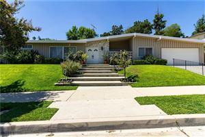 Photo of 18700 PASEO NUEVO Drive, Tarzana, CA 91356 (MLS # SR19192494)