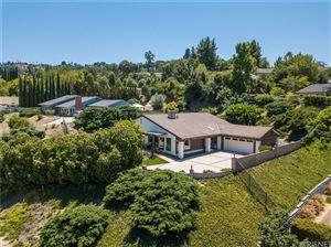 Photo of 21700 MULHOLLAND Drive, Woodland Hills, CA 91364 (MLS # SR19189884)