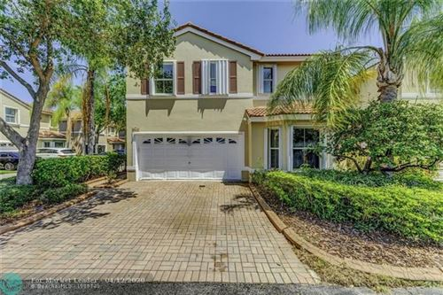 Photo of 945 Scarlet Oak Way, Hollywood, FL 33019 (MLS # F10224356)