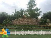 Photo of 8270 NW 127th Ln #8270, Parkland, FL 33076 (MLS # F10140401)
