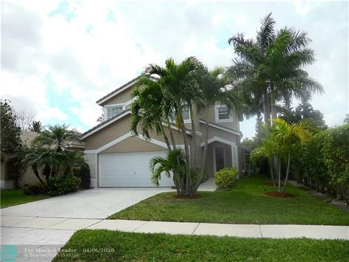 Photo of 7713 NW 70th Ave, Parkland, FL 33067 (MLS # F10224516)