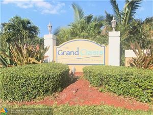 Photo of 5761 Riverside Dr #205B4, Coral Springs, FL 33067 (MLS # F10141905)