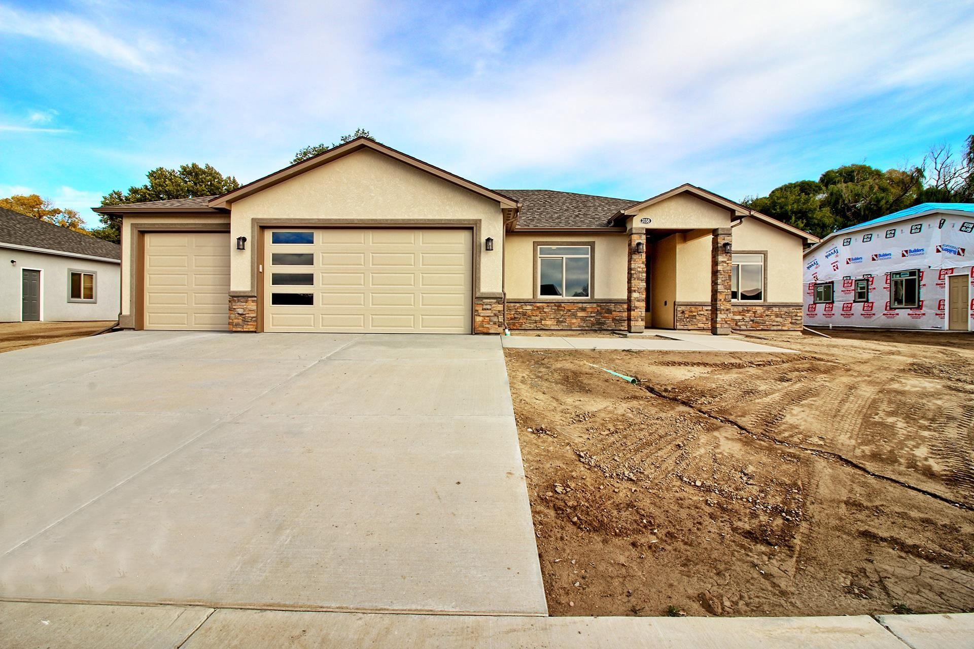 Photo of 3158 Saddle Gulch Drive, Grand Junction, CO 81504 (MLS # 20215703)