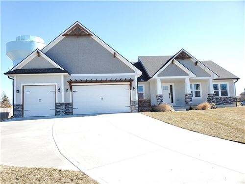 Photo of 825 SE Shamrock Lane, Blue Springs, MO 64014 (MLS # 2208324)
