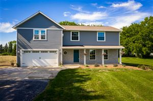 Photo of 12312 W Donges Bay Rd, Mequon, WI 53097 (MLS # 1645910)