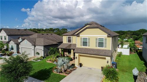 Photo of 14309 FISSORE BOULEVARD, WIMAUMA, FL 33598 (MLS # O5963245)