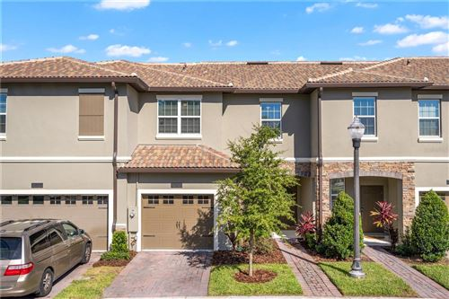 Photo of 8513 PLAYER POINT DRIVE, CHAMPIONS GATE, FL 33896 (MLS # O5976550)