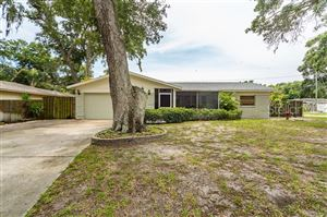 Photo of 9834 55TH AVENUE N, ST PETERSBURG, FL 33708 (MLS # T3179650)