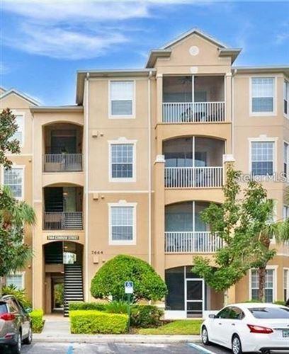 Photo of 7664 COMROW STREET #402, KISSIMMEE, FL 34747 (MLS # O5895941)