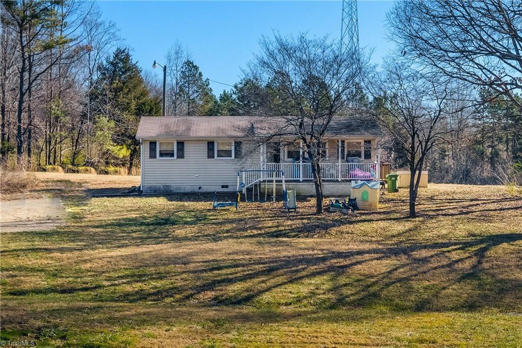 Photo of 327 Sedalia Road, Gibsonville, NC 27249 (MLS # 1013857)