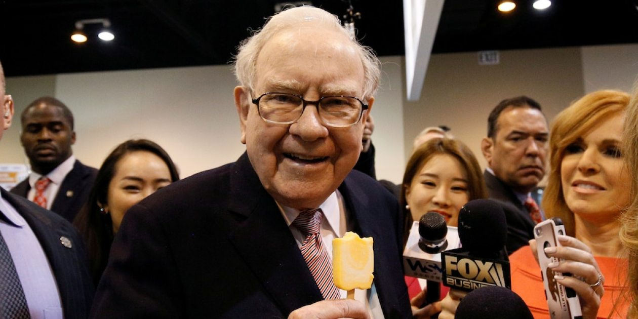 FILE PHOTO: Berkshire Hathaway chairman and CEO Warren Buffett enjoys an ice cream treat from Dairy Queen before the Berkshire Hathaway annual meeting in Omaha, Nebraska, U.S. May 6, 2017. REUTERS/Rick Wilking/File Photo