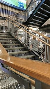 Product And Application Gallery Mcnichols® Wire Mesh Infill | Wire Mesh Stair Railing | Exterior Perforated Metal | Galvanized Mesh | Staircase | Modern | Mesh Balustrade