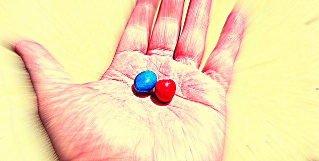 Red and blue pill on hand