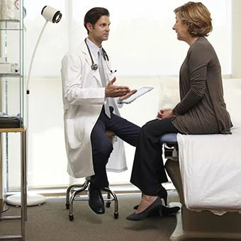 A doctor talks to a female patient.