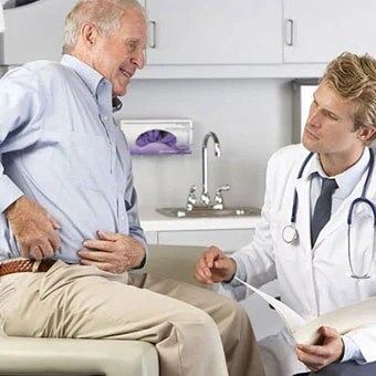 A doctor examines a patient with hip bursitis.