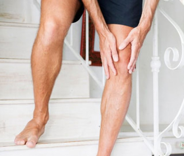 A Man With Knee Pain Has Trouble Walking Down The Stairs