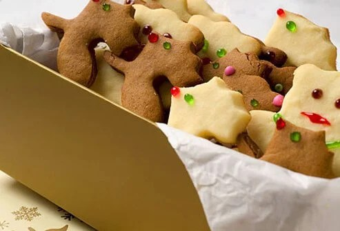 Holiday cookies in a gold box.