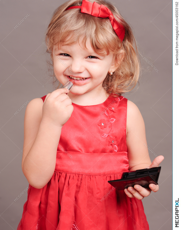 Cute Baby Girl Doing Makeup Stock Photo