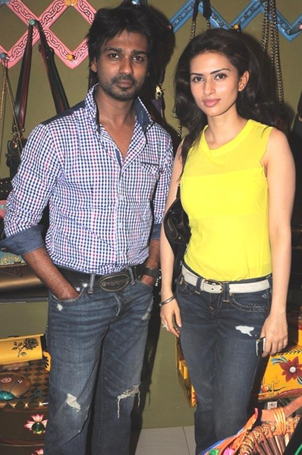 Nikhil Dwiwedi and Gaurie Pandit Poses During The Opening of Fluke Store