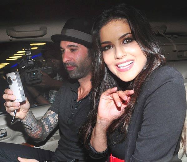 Sunny Leone With Husband Daniel at Mumbai Airport
