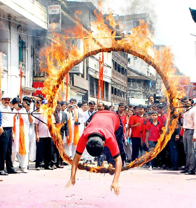 A Man Performed A Daredevil Act Jumping Through A Ring Of Fire