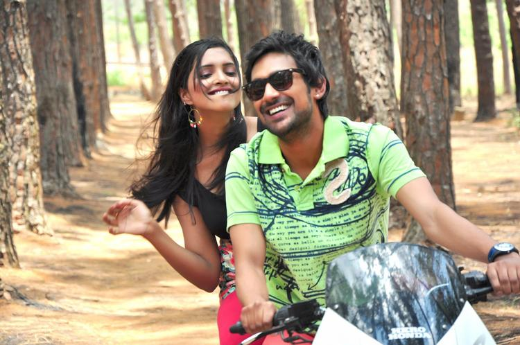 Varun And Sanchita Nice Look With Cute Smiling Still In Bike From Movie Chammak Challo