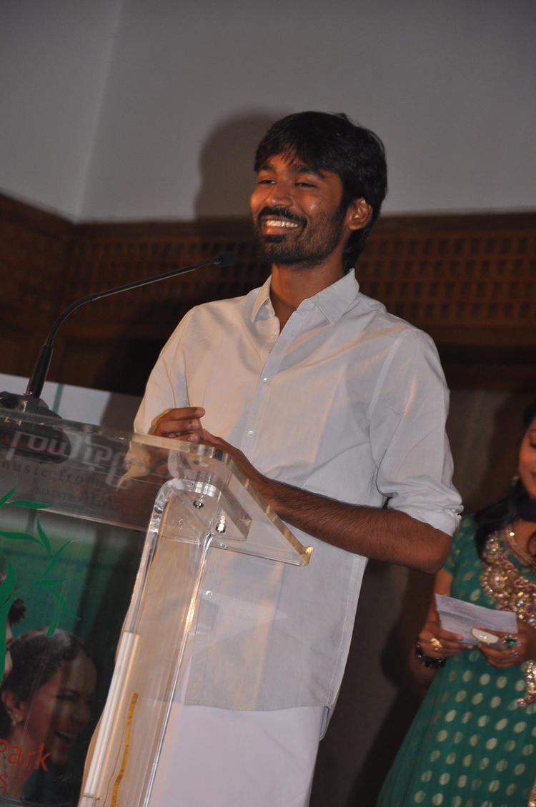 Dhanush Smiling Still At Maranthen Mannithen Movie Audio Launch
