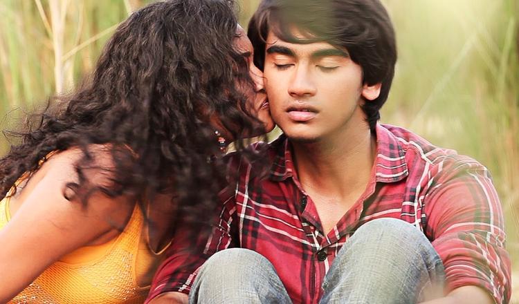 Maithili Kisses Krishna Nice Still From Telisi Teliyaka Movie