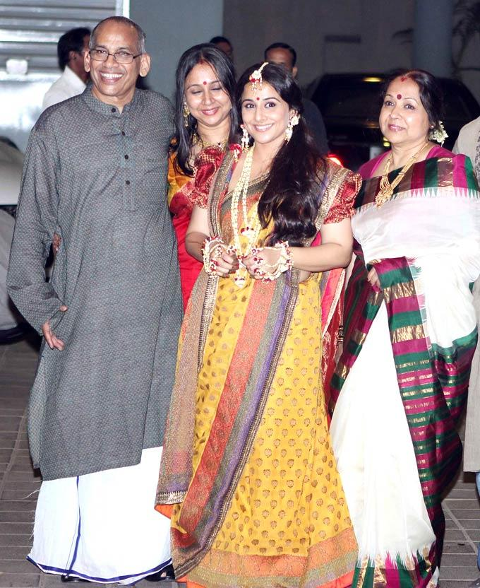 A Beeming Vidya Poses With Her Family For Camera At Her Mehendi Ceremony