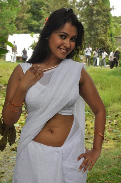 Varsha Looked Bold In Saree For Photo Shoot