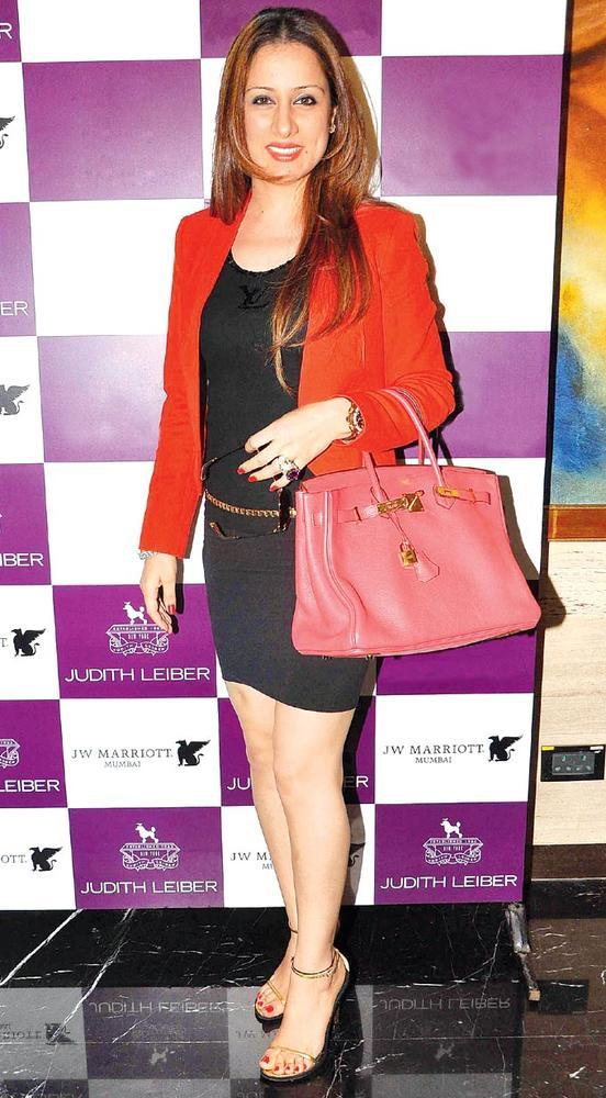 Rouble Flashes A Smile At The Launch Of Judith Leiber New Collection Of Clutches