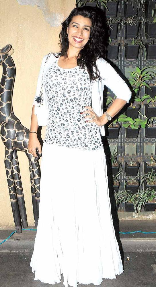 Mink Brar Flashes A Smile At Grace Lagerbay Christmas Bash