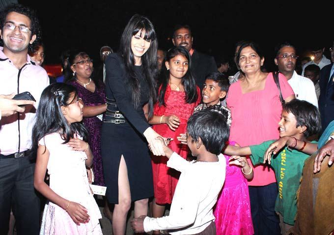 Sherlyn Chopra Shakes Hand With A Kid At Midnight Mass