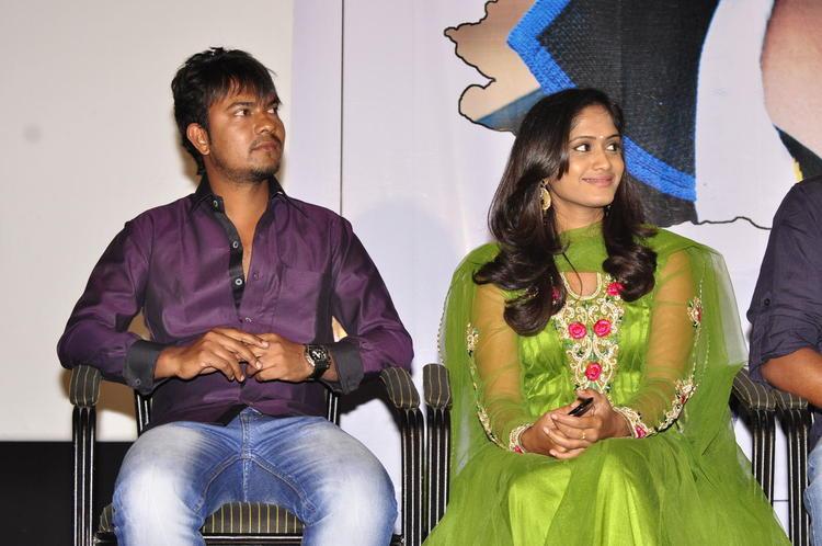 Actor And Actress Smiling Still At Memiddaram Preminchukunnam Movie Audio Launch