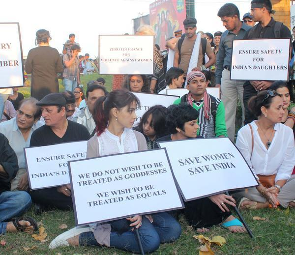 Genelia And Mandira Sitting Position Photo Clicked During Protest Delhi Gang Rape Atrocity