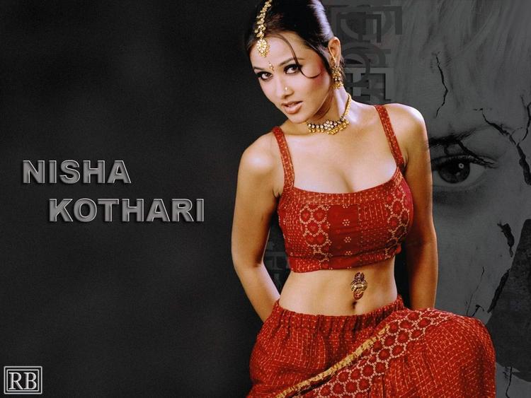 Nisha Kothari Spicy Navel Show Wallpaper In Red Dress