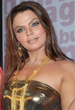 Rakhi Sawant Strapless Dress Glamour Still
