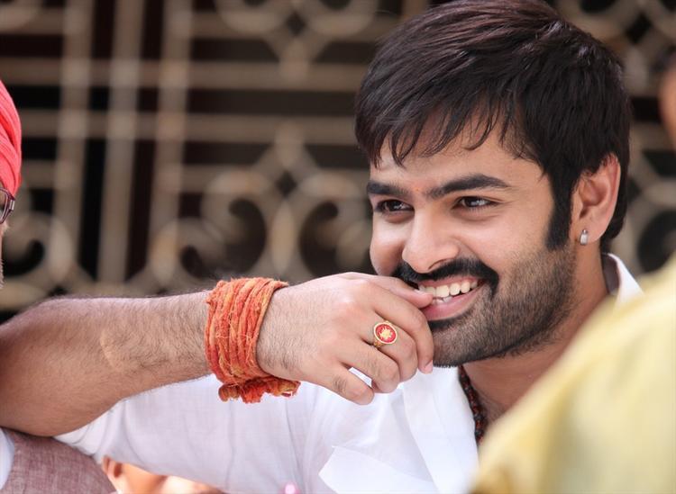 Ram Pothineni Smiling Still From Ongole Githa Movie