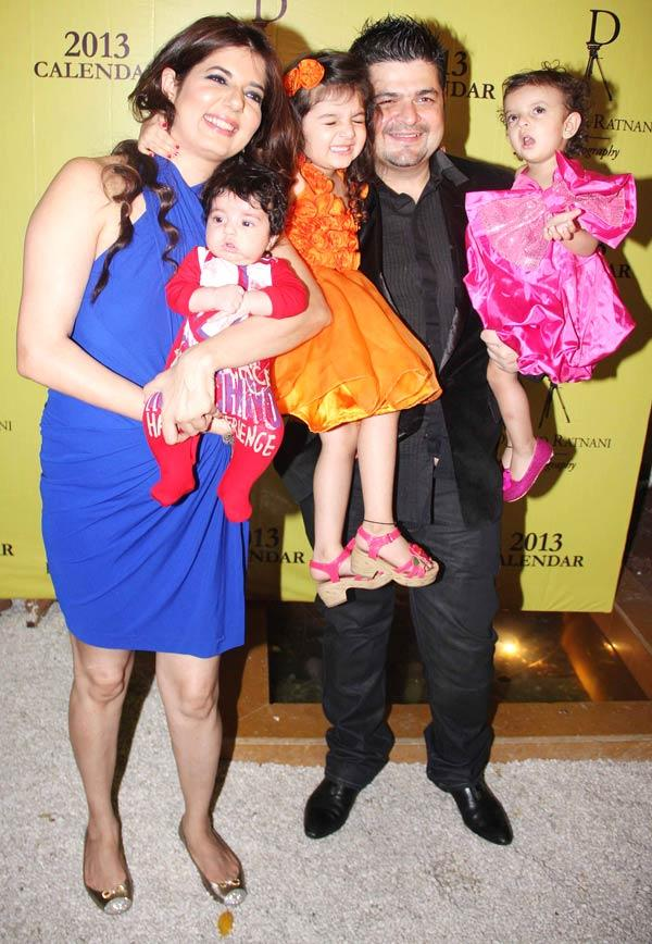 Dabboo And Wife Manisha With Their Children Smiling Pose Photo At His Calender Launch Event