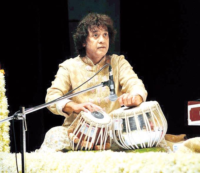 Ustaad Zakir Hussain Is Engrossed In The Tabla Photo Clicked During A Music Concert