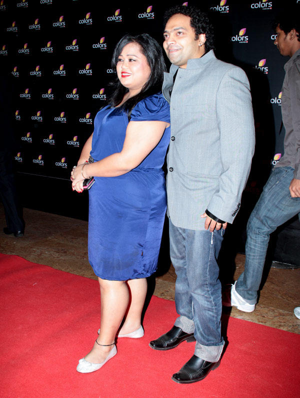 Bharti Singh With Savio Barnes Posed In Red Carpet At Colors 4th Year Celebration Bash