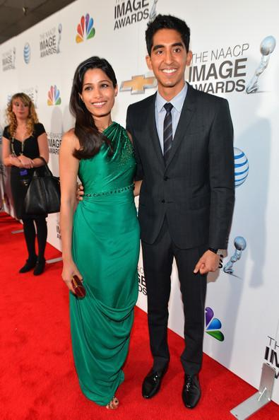 Freida And Dev Smiling Posed In Red Carpet At The 44th NAACP Image Awards
