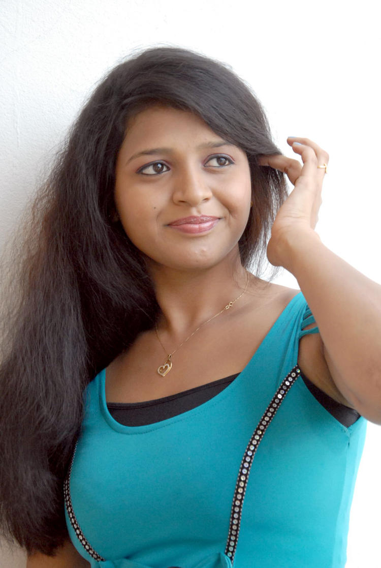 Aswi Completed Her Look With Flowing Hair Still At Amma Nanna Voorelithe Movie Press Meet