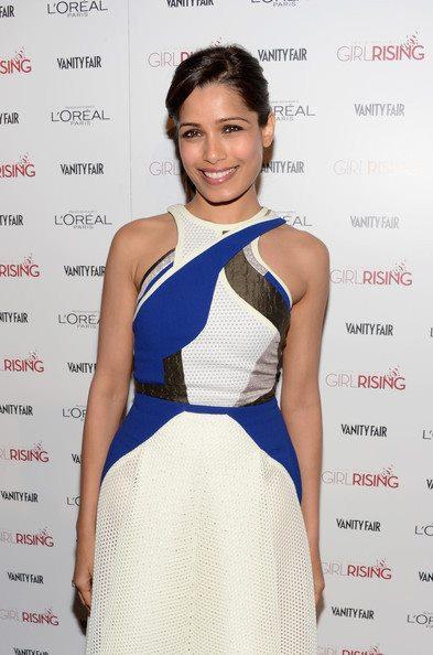 Freida Pinto Flashes A Smiling Pose At Pre-Oscar Bash 2013