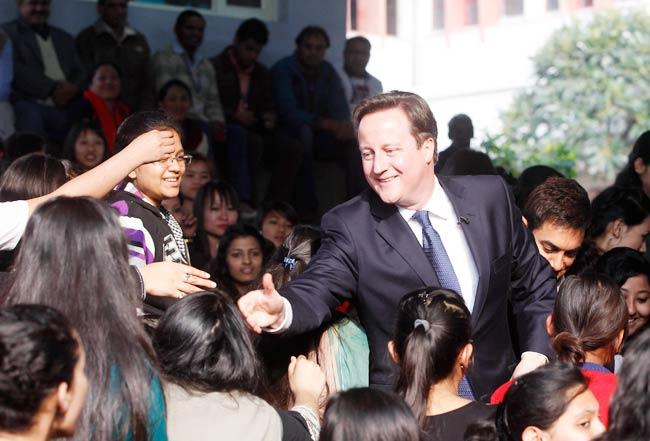 British Prime Minister David Shakes His Hands With Students At Janki Devi Memorial College In Central Delhi