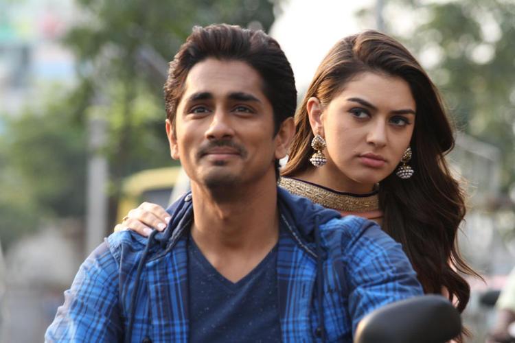 Siddharth And Hansika On Bike Photo Still From Movie Theeya Velai Seiyyanum Kumaru